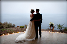 wedding couple looking at the ocean
